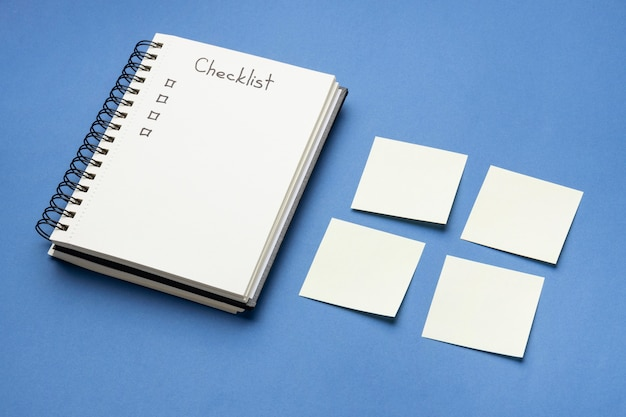 Top view sticky notes with to do list and notebook beside