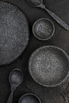 Top view of stone bowls and spoons on slate