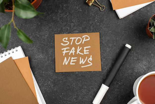 Top view stop fake news concept
