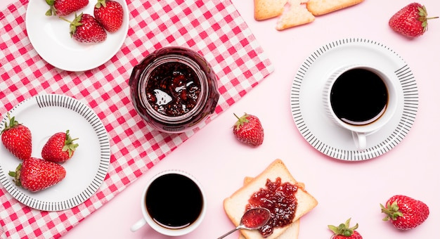 Top view strawberry jam and coffee arrangement