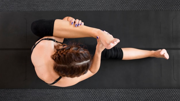 Top view stretching yoga at home concept