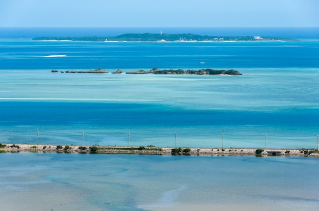 Top view of stunning blue sea main road between sea and river hatoma island on background