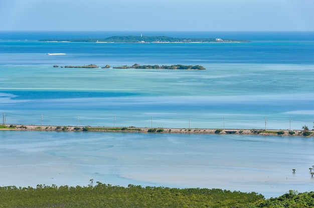 Top view of stunning blue tones sea main road between sea and river hatoma island on background