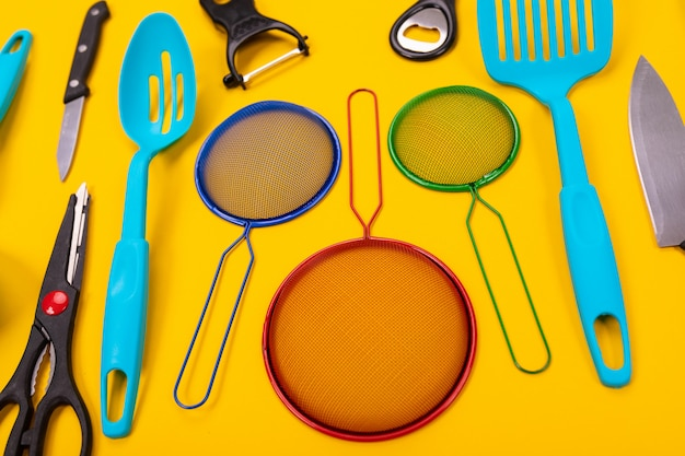 Top view of stylish kitchen utensils isolated on yellow background