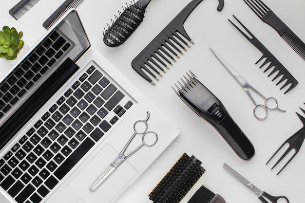 Top view stylist tools and laptop