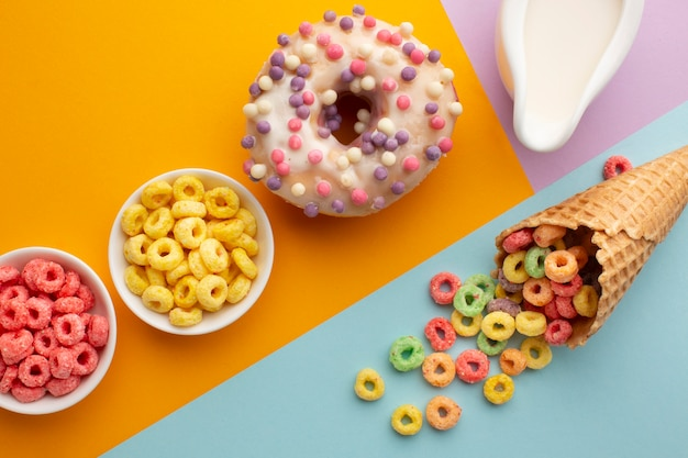 Top view sugar cone with cereal and doughnut