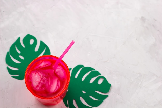 Top view summer coctail ,paper cut monstera leaves, copy space