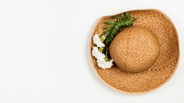 Top view summer hat with flowers