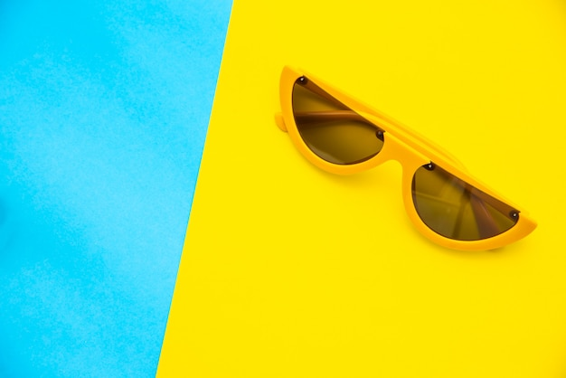 Top view for sunglasses on a colorful background.