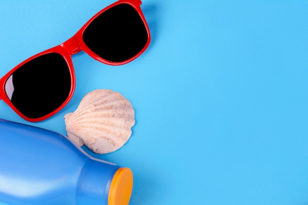 Top view of sunglasses, shells and starfish