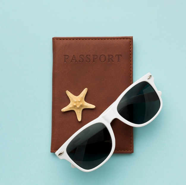 Top view sunglasses with passport