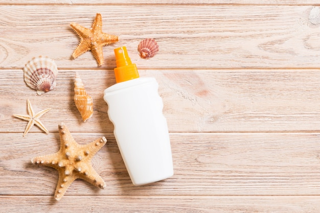 Top view of sunscreen bottle with starfish with copy space. flat lay concept of summer travel vacation