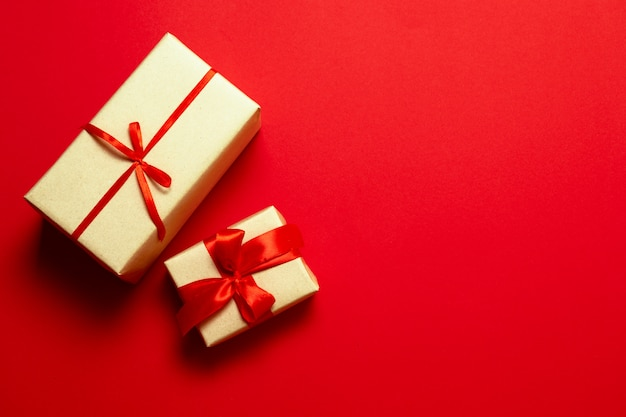 Top view of surprise gifts with red silk ribbons