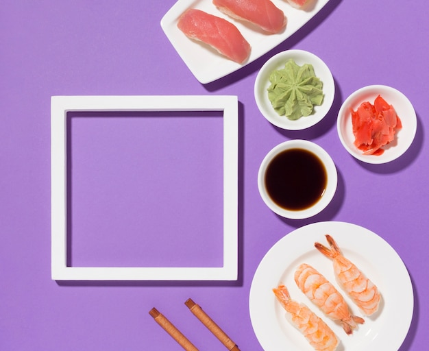 Top view sushi day concept with frame