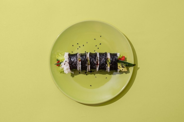 Top view sushi on green plate