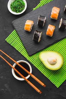 Top view sushi plating on bamboo mat