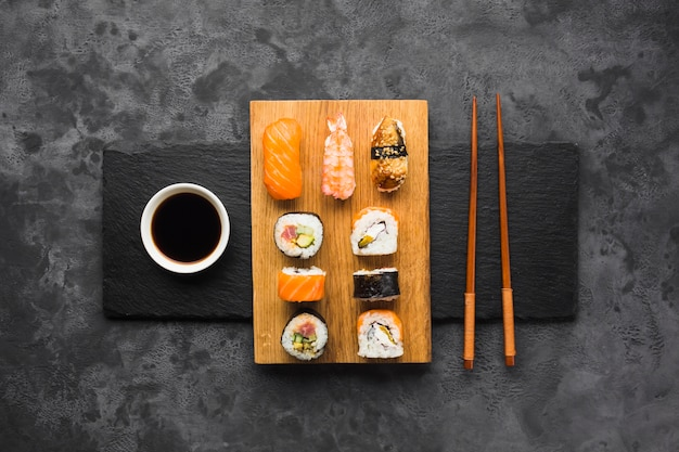 Top view sushi plating on slate background
