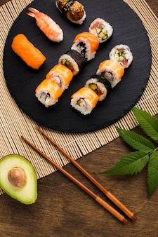 Top view sushi plating on wooden background