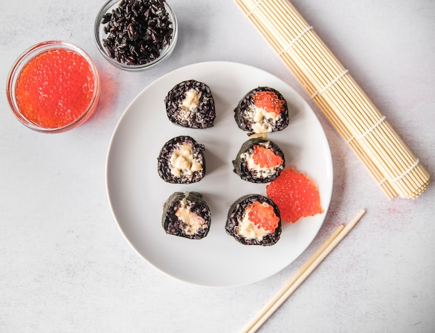 Top view sushi rolls with caviar