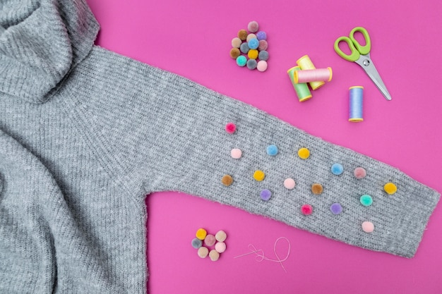 Top view sweater and colorful buttons