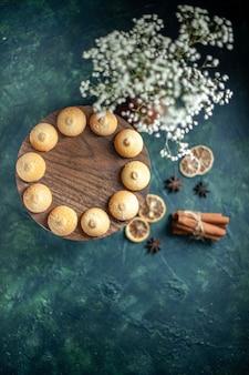 Top view sweet biscuits on blue background cookie sugar cake pie tea photo dessert