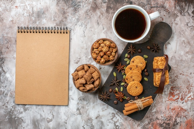 Top view sweet biscuits with coffee and walnuts on the light table cake color