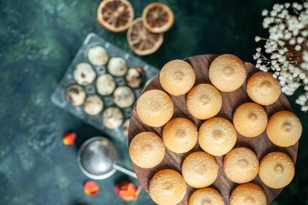 Top view sweet biscuits with milk on dark blue background pie biscuit tea dessert cookie sugar cake