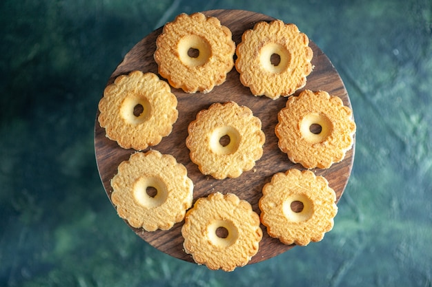 Top view sweet cookies on dark background biscuit sugar cake pie sweet dessert break dough tea