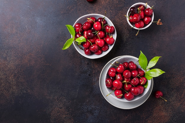 Top view of sweet fresh cherries in bowls