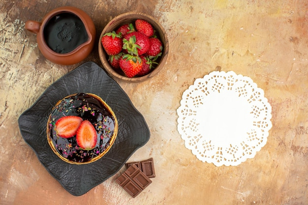 Top view sweet pancakes with fruits on the wooden desk