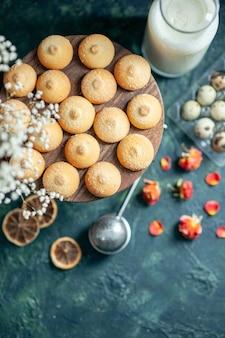 Top view sweet yummy biscuits with milk on dark blue background pie biscuit tea dessert cookie sugar cake