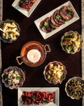 Top view on table served with different gourmet appetizers