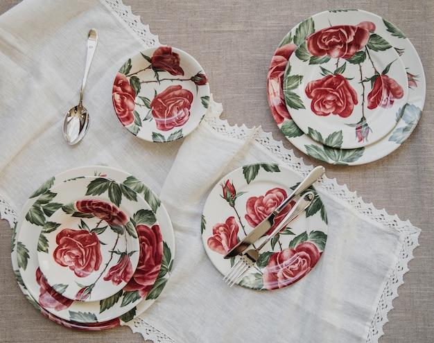 Top view of table setting with plates with colorful flower pattern