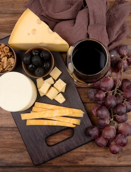 Top view table with cheese selection and wine
