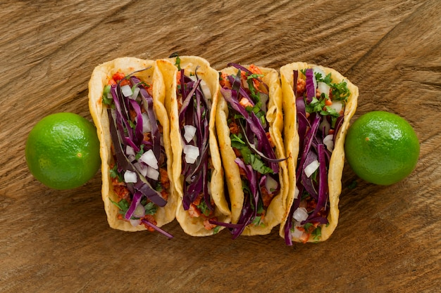 Top view tacos on wooden background