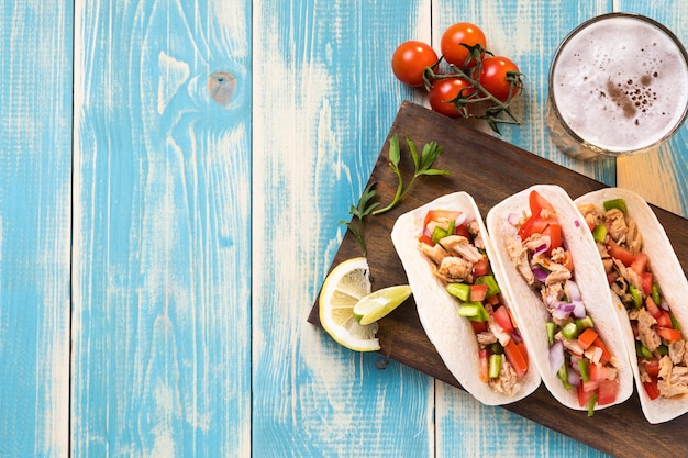Top view tacos on wooden board