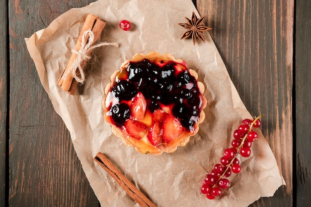 Top view of tart with cinnamon and redcurrants