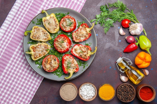 Top view tasty bell-peppers delicious cooked meal with meat and greens on dark surface dinner meal food dish pepper spicy