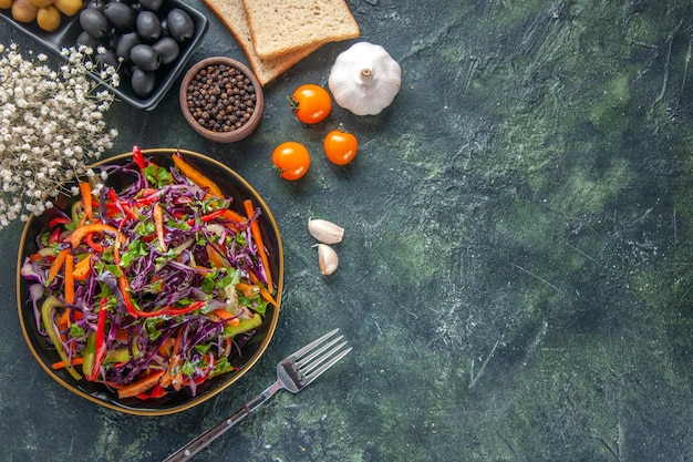 Top view tasty cabbage salad with olives and bread on dark background food bread holiday snack diet health meal lunch