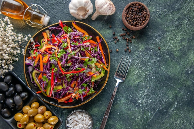 Top view tasty cabbage salad with peppers inside plate on dark background meal health snack diet lunch holiday food