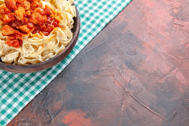 Top view tasty cooked dough with chicken and sauce on dark surface pasta meal dish