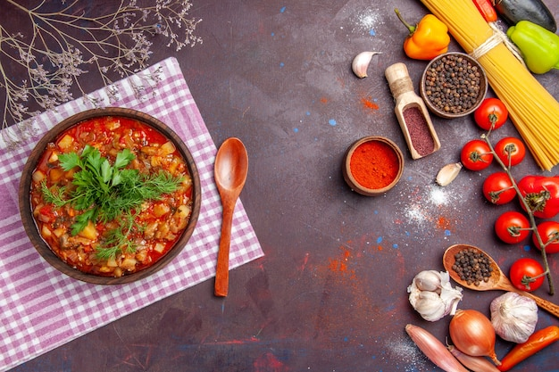 Top view tasty cooked vegetables sauce meal with different seasonings on dark background sauce meal dish food
