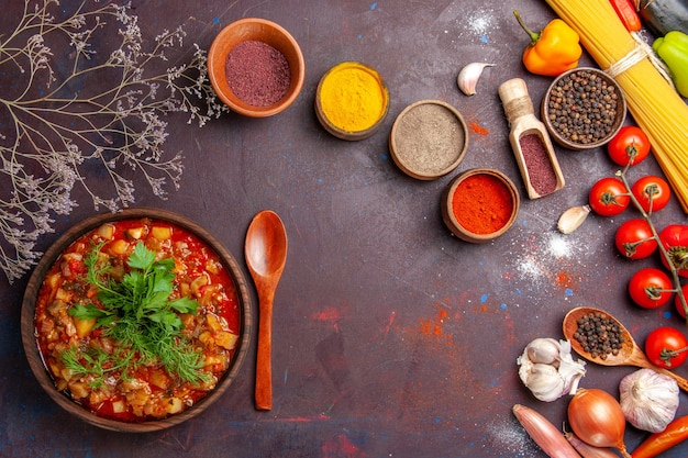 Top view tasty cooked vegetables sauce meal with different seasonings on the dark background sauce meal dish food