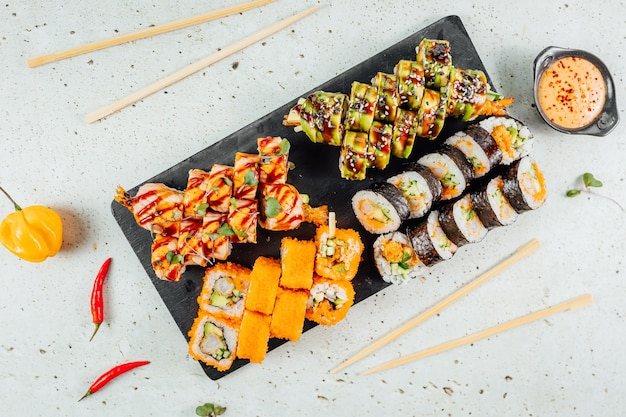 Top view of tasty and delicious sushi on a wooden board