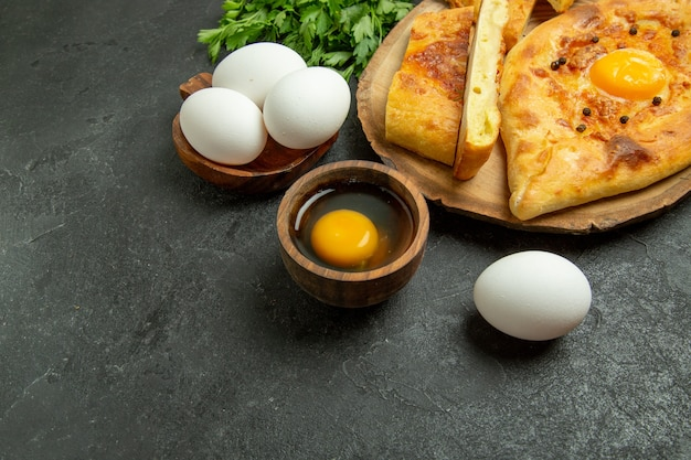 Top view tasty egg bread baked with greens on the grey background bread bun dough food breakfast