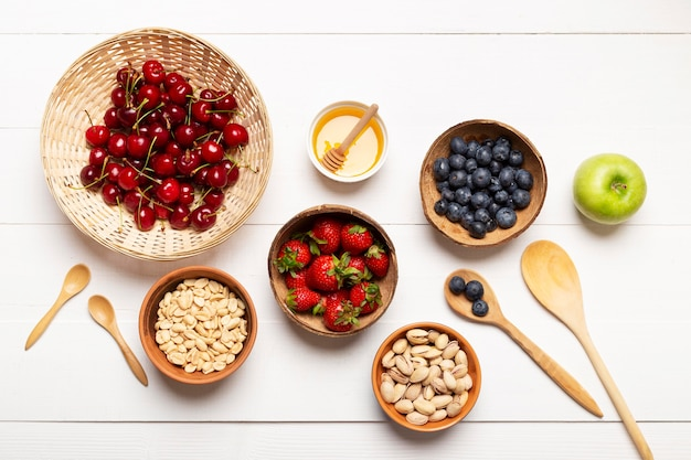 Top view tasty fruits on wooden background