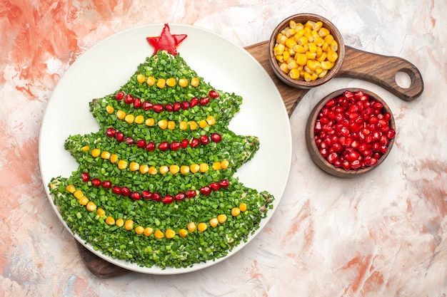 Top view tasty holiday salad in new year tree shape on a light background