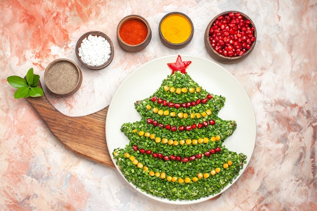 Top view tasty holiday salad in new year tree shape on light background