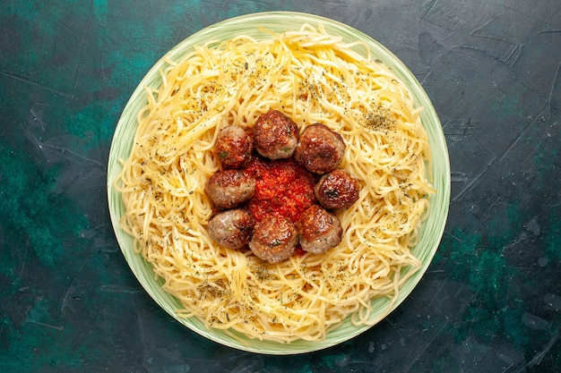 Top view tasty italian pasta with meatballs on dark-blue background