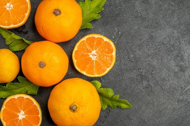 Top view tasty juicy tangerines on the dark background